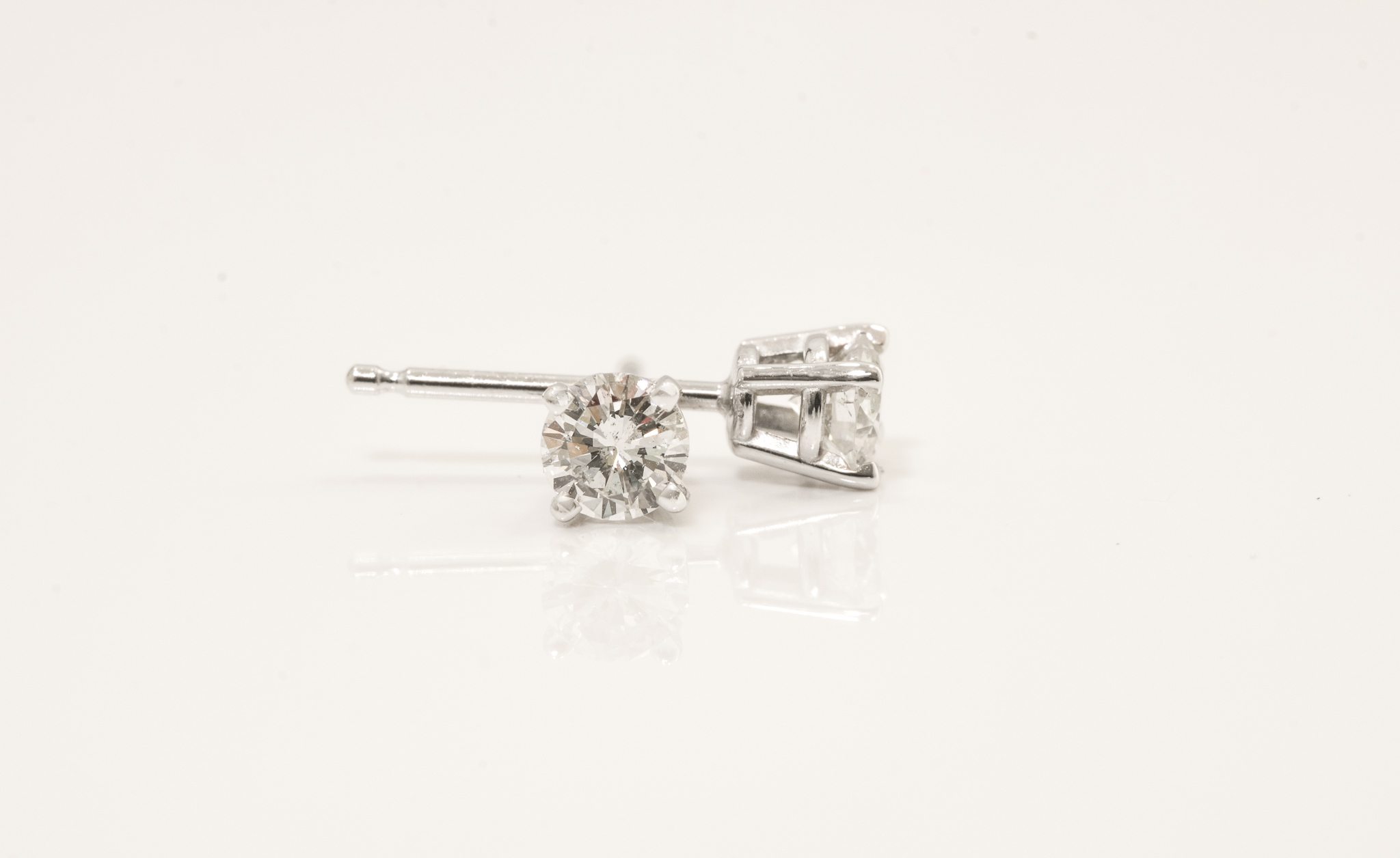 .38 Carat Diamond Stud Earrings. H, SI1.  Round Cut Set in 14 kt. White Gold.