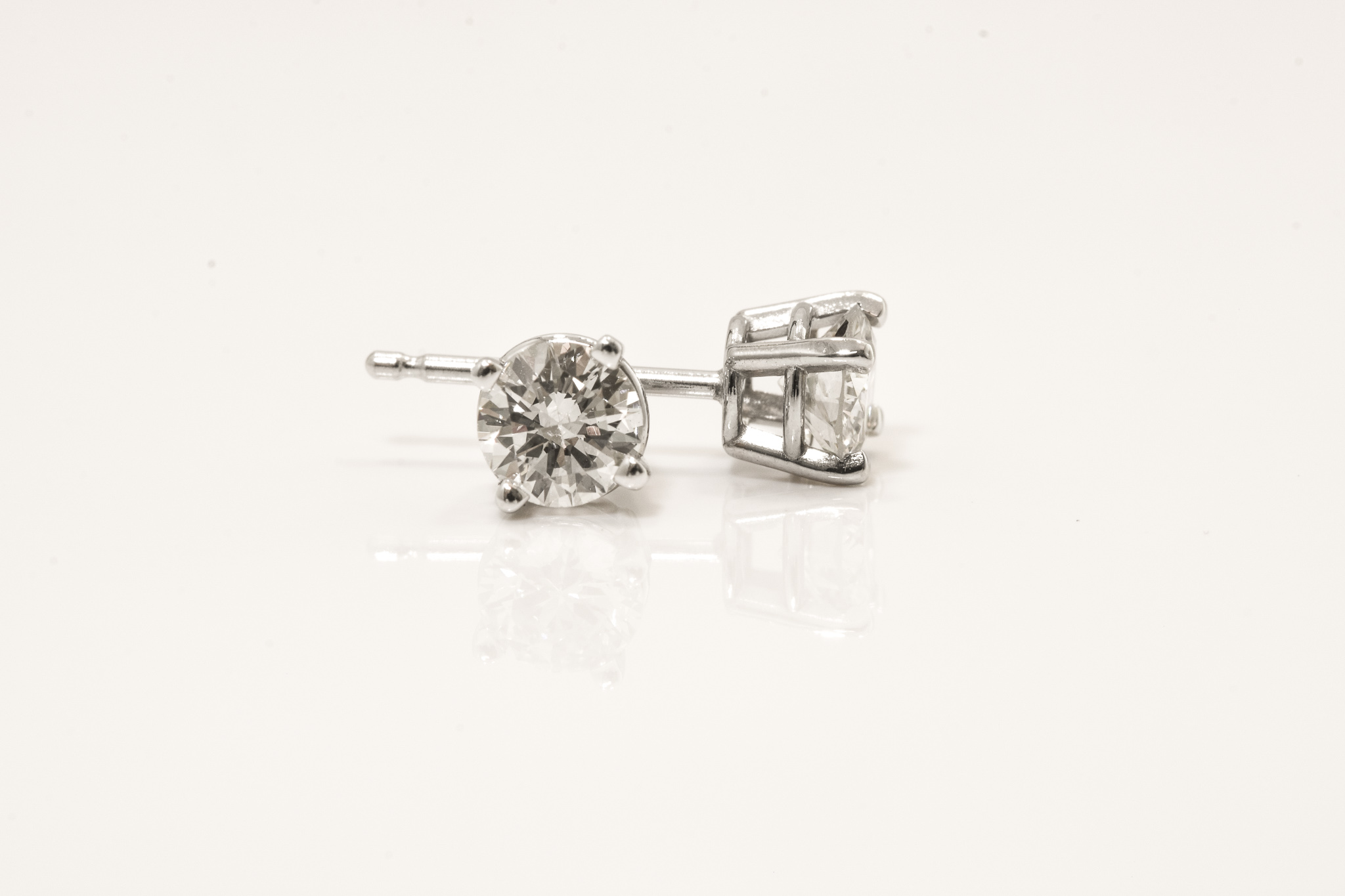 14 kt. White Gold Diamond Stud Earrings.  .54 ct. tdwt.  SI2, H, Set with Round Cut Diamonds.