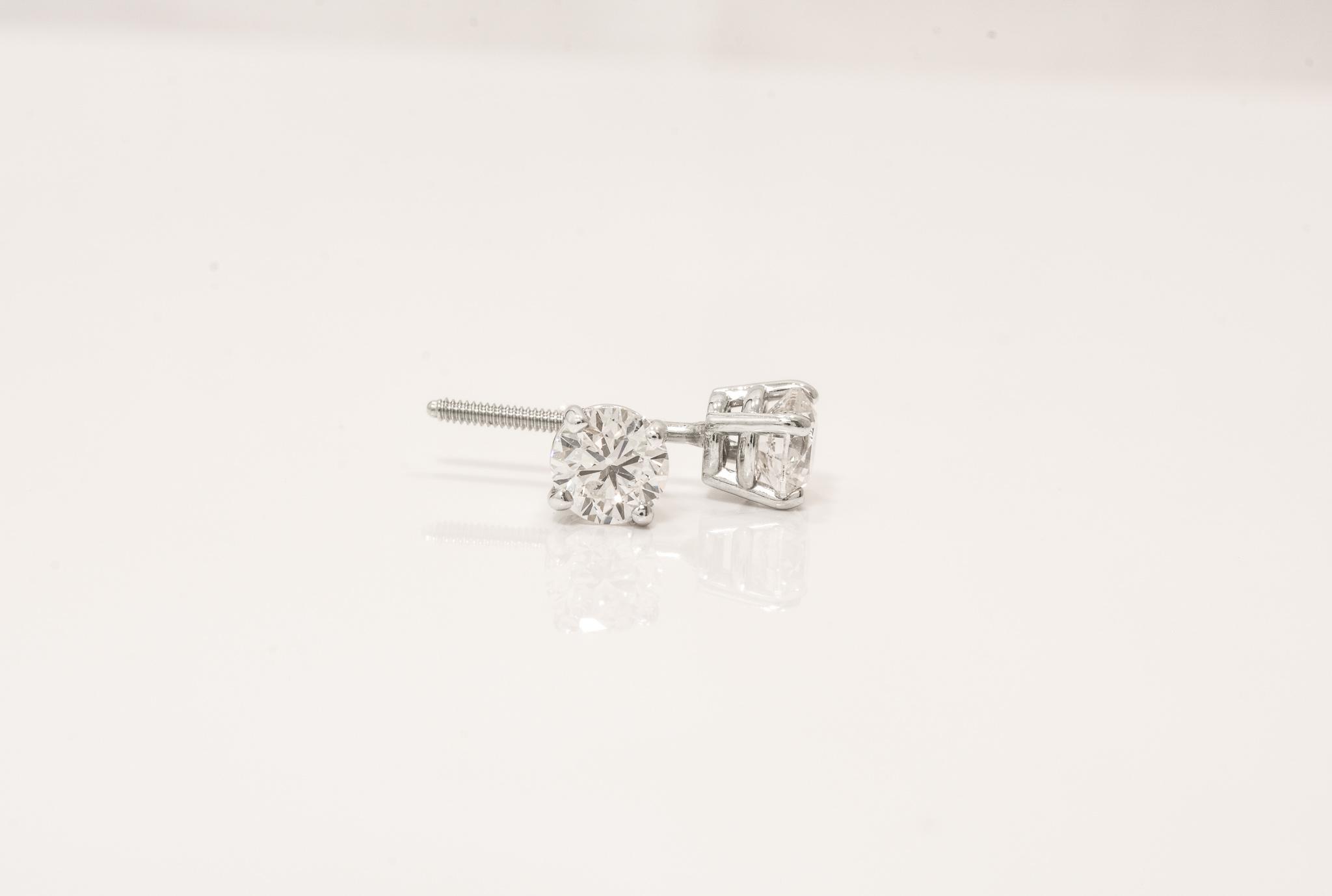 14 kt. White Gold Diamond Stud Earrings.  .86ct. tdwt. I1,H Certified.